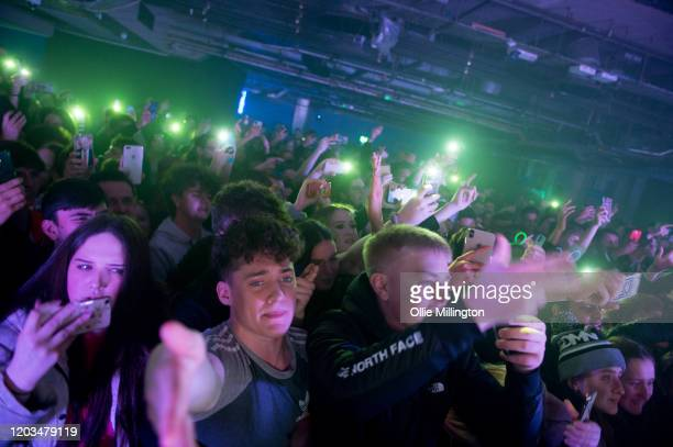The crowd watches on as KSI performs onstage at O2 Academy Islington on February 1, 2020 in London, England.