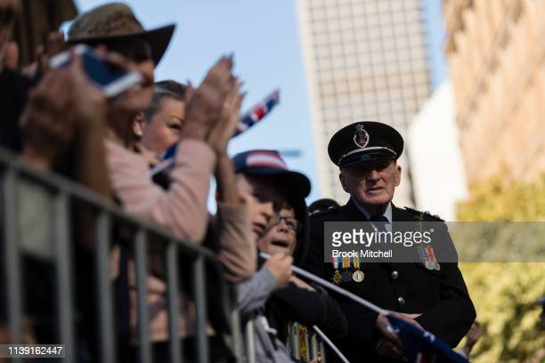 The crowd watches on during the ANZAC Day March on April 25 2019 in Sydney Australia Australians commemorating 104 years since the Australian and New...
