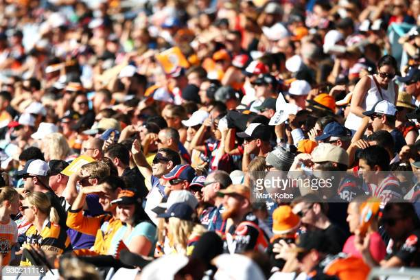 The crowd watches on during the round one NRL match between the Wests Tigers and the Sydney Roosters at ANZ Stadium on March 10 2018 in Sydney...