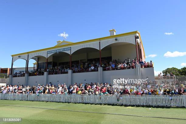 The crowd watches the Queensland team celebrate victory during day four of the Sheffield Shield Final match between Queensland and New South Wales at...