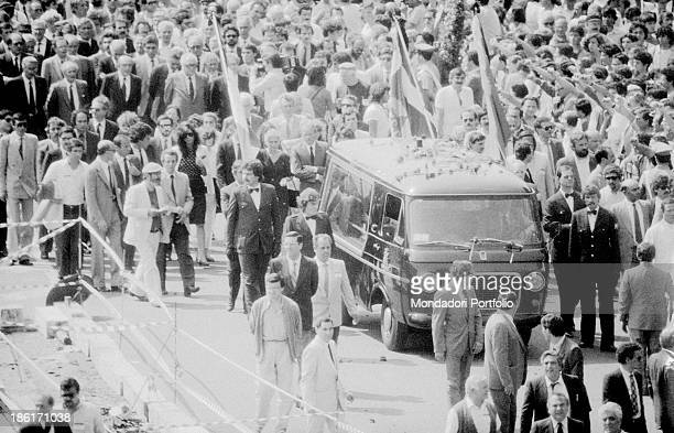 The crowd watching the coffin of the General Secretary of the Italian Communist Party Enrico Berlinguer passing by Rome 13th June 1984