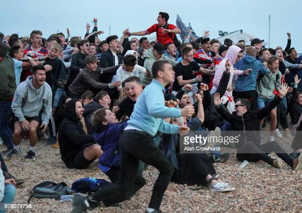 The crowd watching the match at Lunar cinema on Brighton beach react to Englands Harry Kane as he scores the winner as England play Tunisia in the...