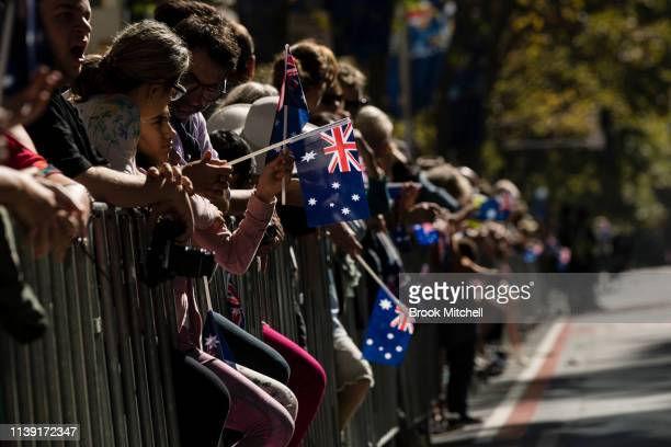 The crowd waves Australian flags during the ANZAC Day March on April 25 2019 in Sydney Australia Australians commemorating 104 years since the...