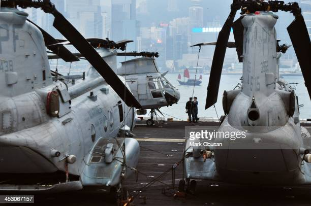 CONTENT] The crowded flight deck of this Tarawaclass amphibious assault ship bristles with the 15th Marine Expeditionary Unit Aviation Combat...