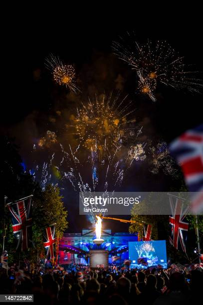 The crowds enjoy the fireworks over Buckingham Palace during the finale of the Diamond Jubilee Buckingham Palace Concert on June 4 2012 in London...