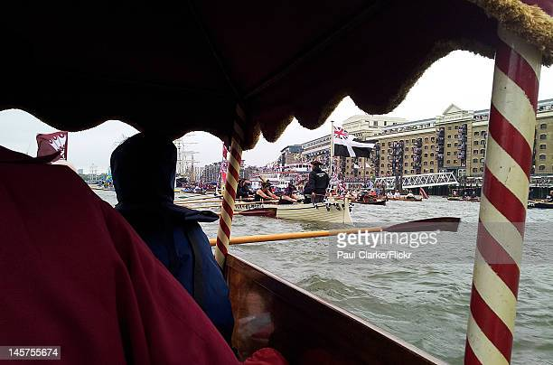 The crowds massed on Butler's Wharf seen through the canopy of the Barbers' Cutter a traditional Thames Waterman's Cutter