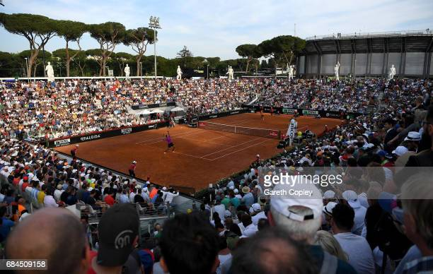 The crowds watch as Juan Martin Del Potro of Argentina serves to Kei Nishikori of Japan during their 3rd round match in The Internazionali BNL...
