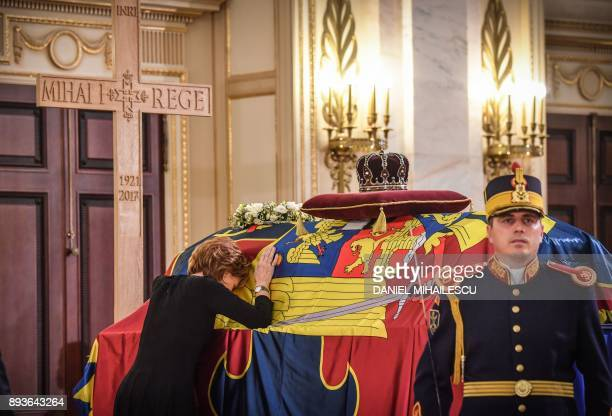 The crown custodian Princess Margaret daughter of King Michael of Romania leans on the King's coffin inside the former Royal Palace that houses the...
