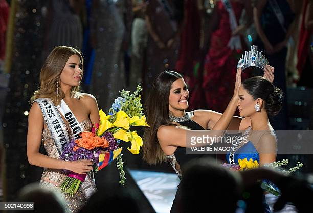 The crown is removed from Miss Colombia Ariadna Gutierrez by Miss Universe 2014 Paulina Vega after the pageant's host misread the card that actually...