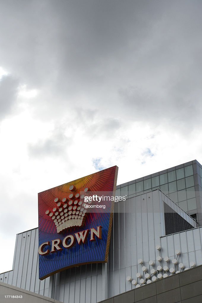 The Crown Ltd. logo is displayed outside the Crown Melbourne casino and entertainment complex in Melbourne, Australia, on Wednesday, Aug. 21, 2013. Crown Ltd., the gaming company controlled by billionaire James Packer, is scheduled to announce full-year results on Aug. 23. Photographer: Carla Gottgens/Bloomberg via Getty Images