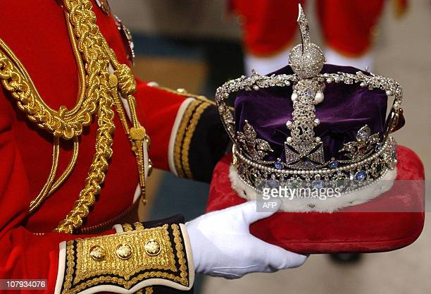 The crown of Britain's Queen Elizabeth II is carried into the House of Lords for the State Opening of Parliament 23 November 2004, in London. The...