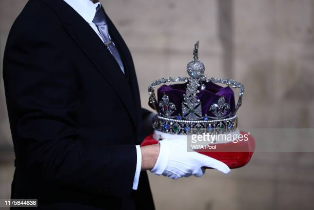 The crown of Queen Elizabeth II is carried during for the State Opening of Parliament at the Palace of Westminster on October 14 2019 in London...