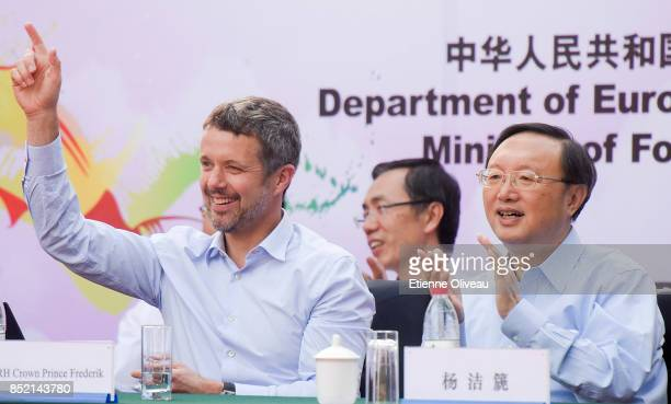 The Crown Prince Frederik of Denmark and Chinese State Counsellor Yang Jiechi celebrate after the first goal in the final of the 3rd SinoNordic Cup...
