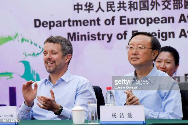 The Crown Prince Frederik of Denmark and Chinese State Counsellor Yang Jiechi applause the start of the final in the 3rd SinoNordic Cup Football...