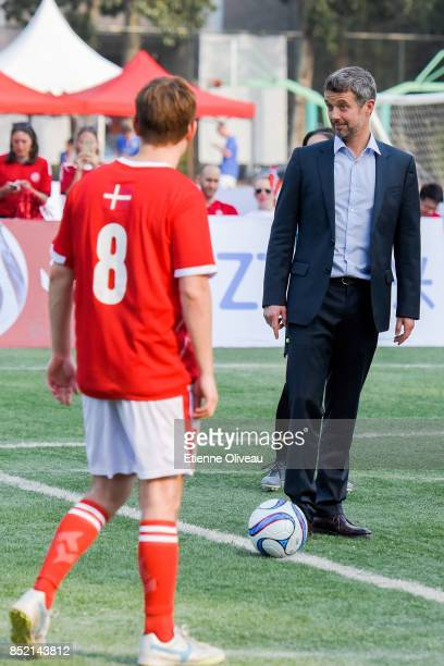 The Crown Prince Frederik of Denmark kicks off the final in the 3rd SinoNordic Cup Football Tournament between Denmark and the Chinese Football...