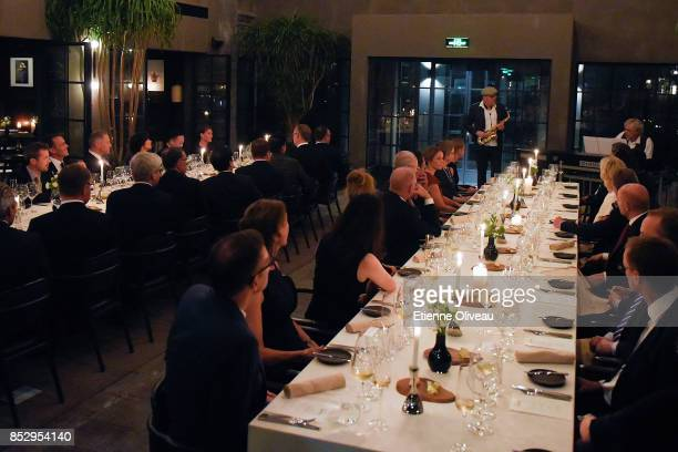 The Crown Prince Frederik of Denmark listens to the jazz duo Anders and Benjamin Koppel during a dinner hosted by the Danish Industry Foundation and...