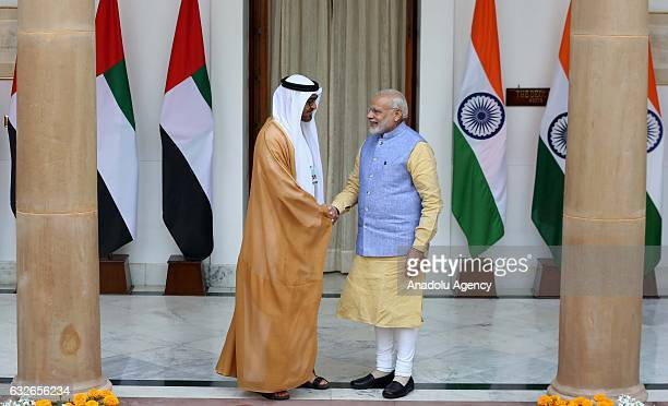 The Crown Prince of Abu Dhabi General Sheikh Mohammed Bin Zayed Al Nahyan shakes hands with Indian Prime Minister Narendra Modi ahead of a meeting at...