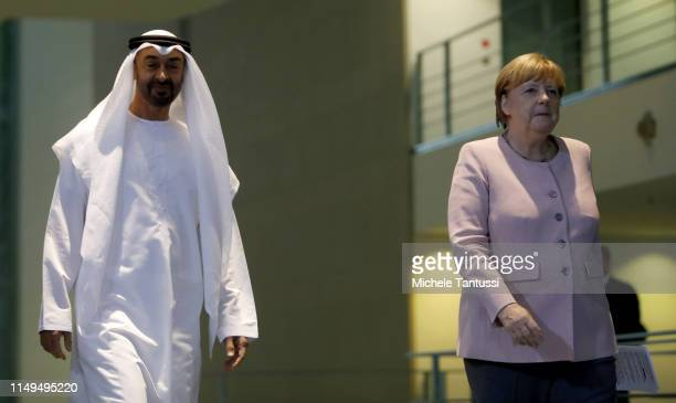 The Crown Prince of Abu Dhabi Mohammed bin Zayed Al Nahyan and German Chancellor Angela Merkel arrive to speak to the media prior to talks at the...
