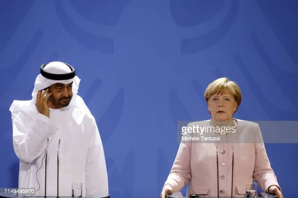 The Crown Prince of Abu Dhabi Mohammed bin Zayed Al Nahyan and German Chancellor Angela Merkel speak to the media prior to talks at the Chancellery...