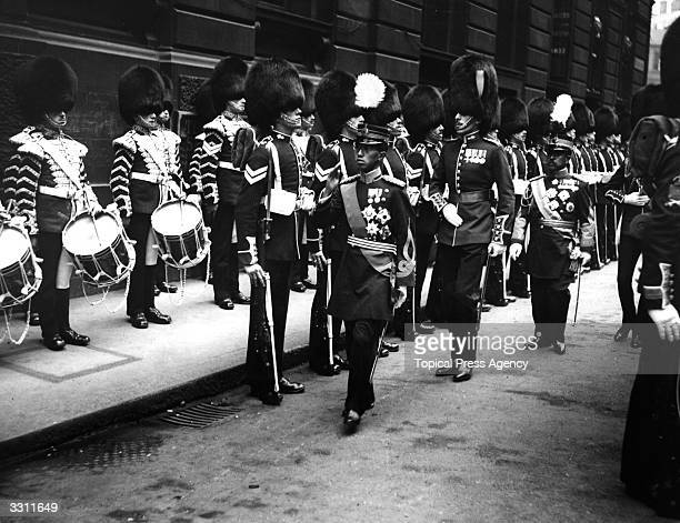 The Crown Prince of Japan, Hirohito , later Emperor Hirohito, inspects a Guard of Honour in the City of London, May 1921.