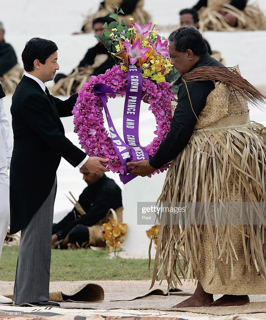 The Crown Prince of Japan, Prince Naruhito (L), delivers a wreath to the Tongan royal undertaker for the tomb of the late King Taufa'ahau Tupou IV at his state funeral on September 19, 2006 in Nuku'alofa, Tonga. King Taufa'ahau Tupou IV died on September 10, 2006 after a long illness. He was 88 and had been ruler of Tonga since the death of his mother in 1965. Crown Prince Tupouto'a has taken over the king's duties.