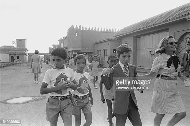 The crown prince Sidi Mohammed with children in a street in Skirat