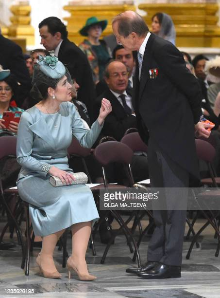 The Crown Princess Elia of Albania speaks with Duarte Pio, Duke of Braganza, as they attend the wedding ceremony of Grand Duke George Mikhailovich...