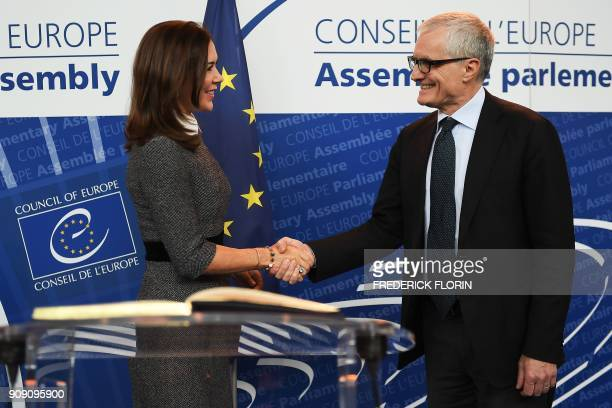 The Crown Princess of Denmark and Countess of Monpezat Mary Donaldson shakes hand with the new President of the Parliamentary Assembly of the Council...