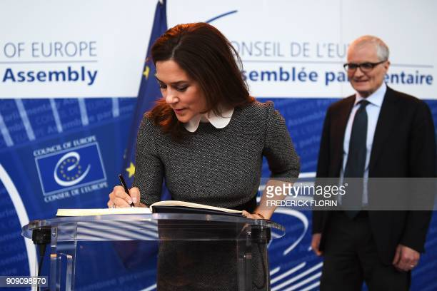 The Crown Princess of Denmark and Countess of Monpezat Mary Donaldson signs a guest book as the new President of the Parliamentary Assembly of the...