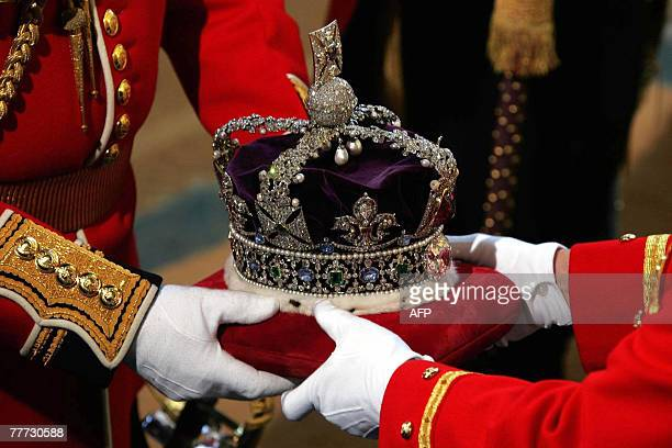 The crown to be worn by Queen Elizabeth II arrives at the Soverign Entrance of the House of Lords, in Westminster, in London, 06 November 2007, for...