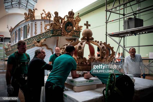 The crown which makes up part of the France's Imperial Canoe of Napoleon I is dismantled before being transferred along with the boat from the Musée...