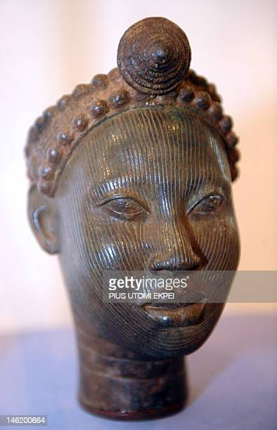 The Crowned Head of an Ooni of Ife a freestanding copper alloy sculpted between 14th early15th century is displayed during the 'Dynasty and Divinity...