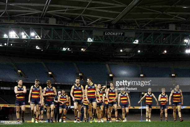 The Crows celebrate victory after the round 20 AFL match between Adelaide Crows and Hawthorn Hawks at Marvel Stadium on July 24, 2021 in Melbourne,...