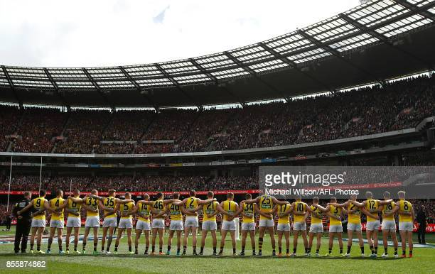 The Crows line up for the national anthem during the 2017 Toyota AFL Grand Final match between the Adelaide Crows and the Richmond Tigers at the...