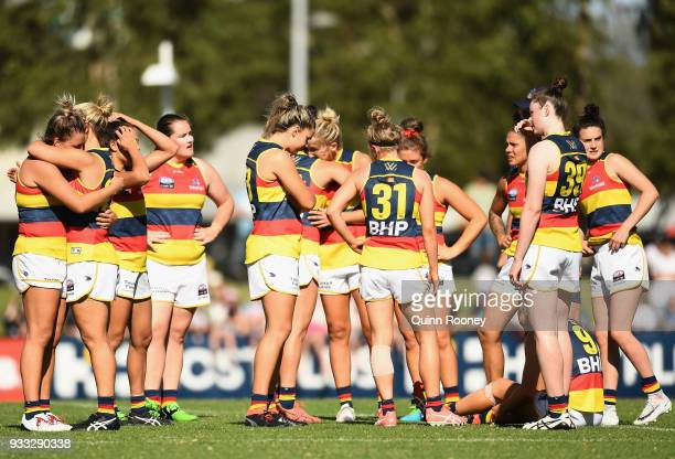 The Crows look dejected after losing the round seven AFLW match between the Collingwood Magpies and the Adelaide Crows at Olympic Park on March 18...