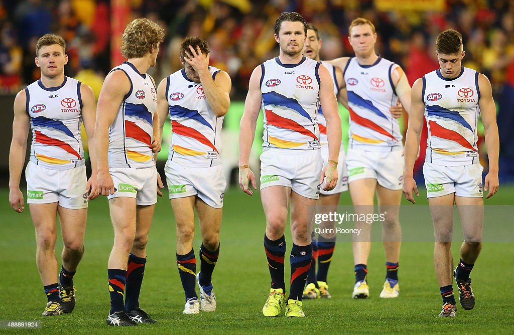 The Crows look dejected after losing the Second AFL Semi Final match between the Hawthorn Hawks and the Adelaide Crows at the Melbourne Cricket Ground on September 18, 2015 in Melbourne, Australia.