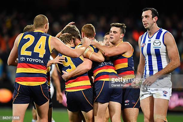 The Crows players react after kicking a goal during the round 14 AFL match between the Adelaide Crows and the North Melbourne Kangaroos at Adelaide...