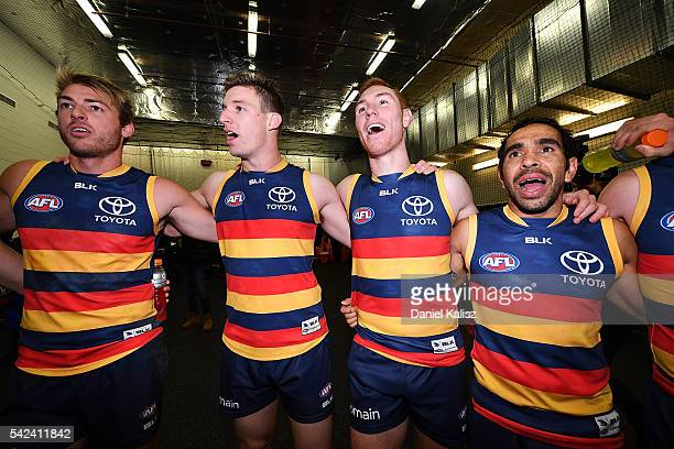The Crows players sing the club song after the round 14 AFL match between the Adelaide Crows and the North Melbourne Kangaroos at Adelaide Oval on...
