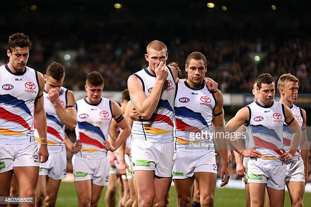 The Crows players walk from the field after being defeated during the round 15 AFL match between the West Coast Eagles and the Adelaide Crows at...