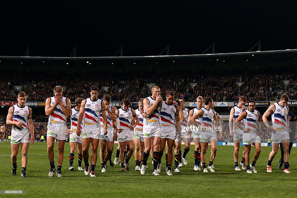 The Crows players walk from the field after being defeated during the round 15 AFL match between the West Coast Eagles and the Adelaide Crows at Domain Stadium on July 11, 2015 in Perth, Australia.