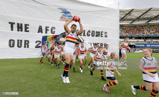 The Crows run out during the round nine AFL match between the Brisbane Lions and the Adelaide Crows at The Gabba on May 18 2019 in Brisbane Australia