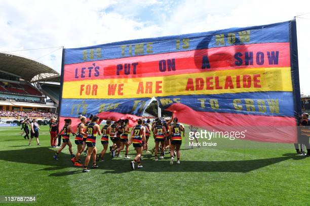 The Crows run through the banner during the AFLW Preliminary Final match between the Adelaide Crows and thew Geelong Cats at Adelaide Oval on March...