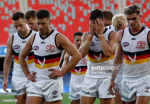 The Crows walk off the ground after they were defeated by the Kangaroos during the round nine AFL match between North Melbourne Kangaroos and the...