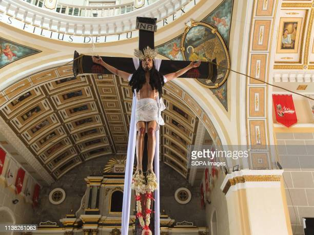 The crucified Sto Entierro de Malabon replica seen being erected at the altar of the San Bartolome Church during Good Friday Every Good Friday the...
