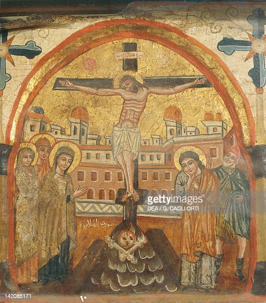 The Crucifixion by an unknown artist from the Byzantineinfluenced Coptic school Wooden icon Church of St Barbara Cairo Egypt 14th Century
