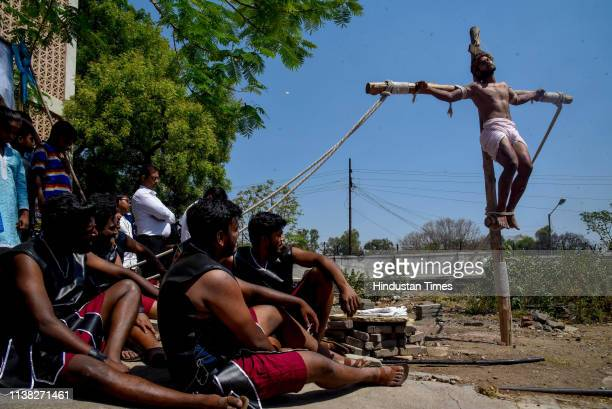 The crucifixion of Jesus Christ enacted by devotees at St. Patricks Cathedral on the occasion of Good Friday, on April 19, 2019 in Pune, India. Good...
