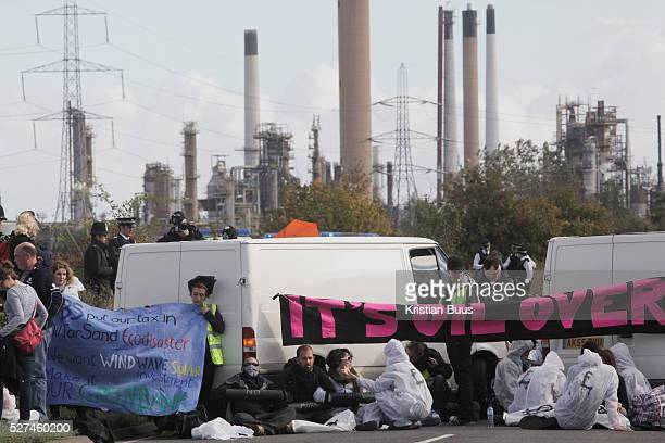 The Crude Awakening blockade on the road to the Coryton oil refinery 12 women locked themselves under 2 white vans in the morning and was later...