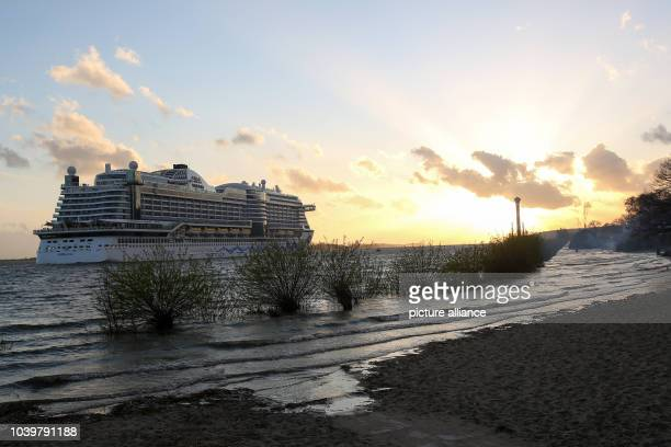The cruise ship 'Aida Prima' sails during high tide towards a beach on the Blankensee in Hamburg Germany 15 April 2017 Traditional Easter fires were...
