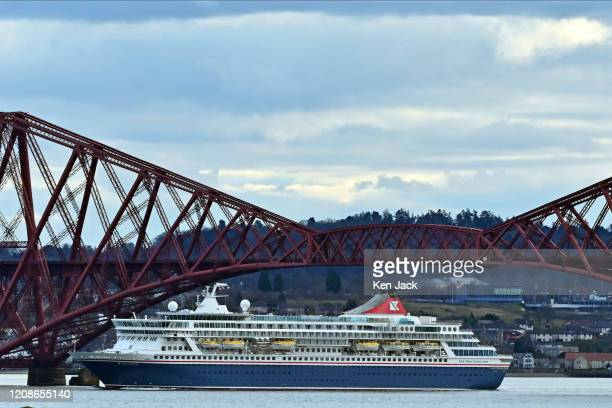 The cruise ship Balmoral passes under the Forth Bridge the main rail route from Edinburgh to the north after the announcement of further cutbacks on...