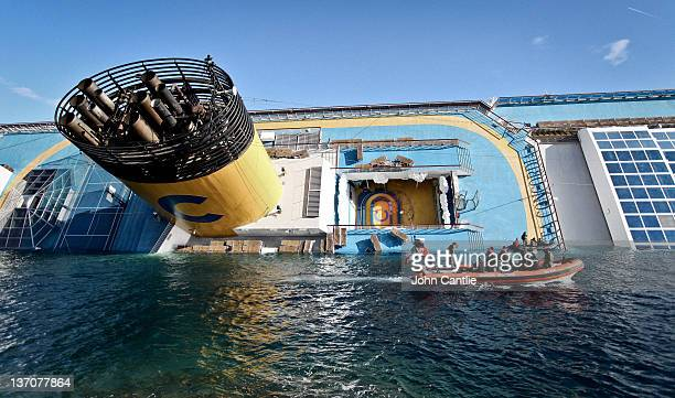 The cruise ship Costa Concordia lies stricken off the shore of the island of Giglio on January 15 2012 in Giglio Porto Italy Three survivors have...